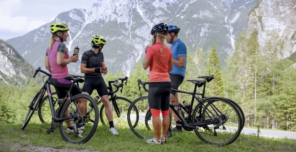 Bicycle riders relaxing and standing together