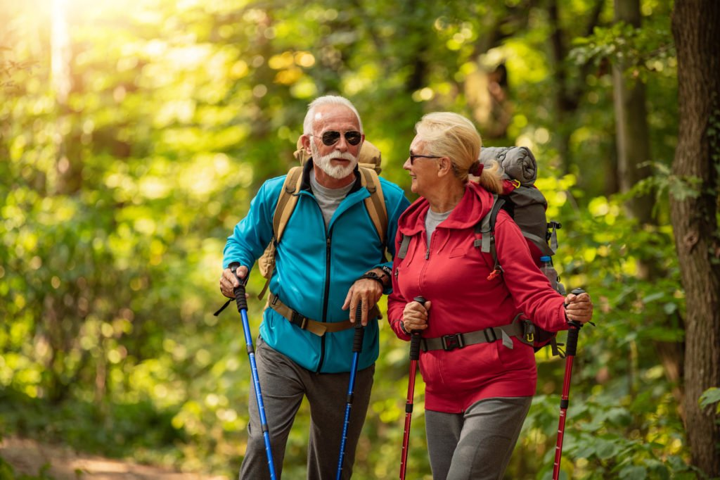 Senior couple is hiking in forest.Adventure, travel,hike and people concept