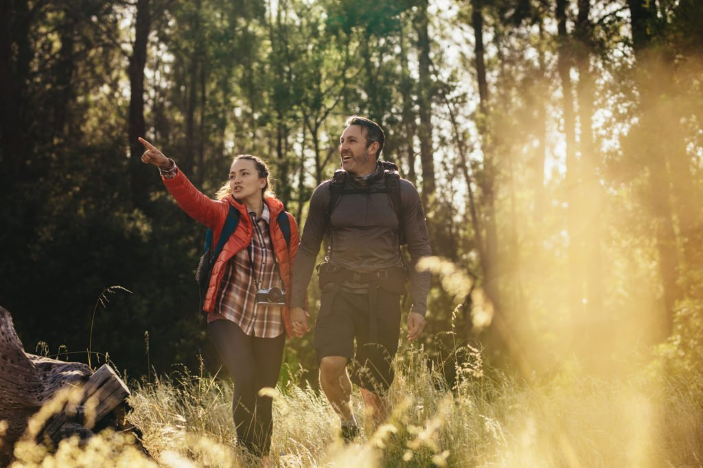 Couple hiking through forest trails